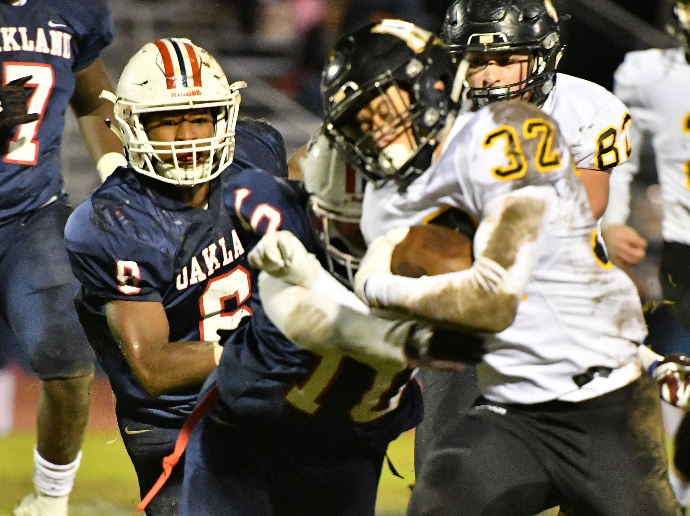 Hendersonville's Derek Kincaid gains yardage Friday night against Oakland.