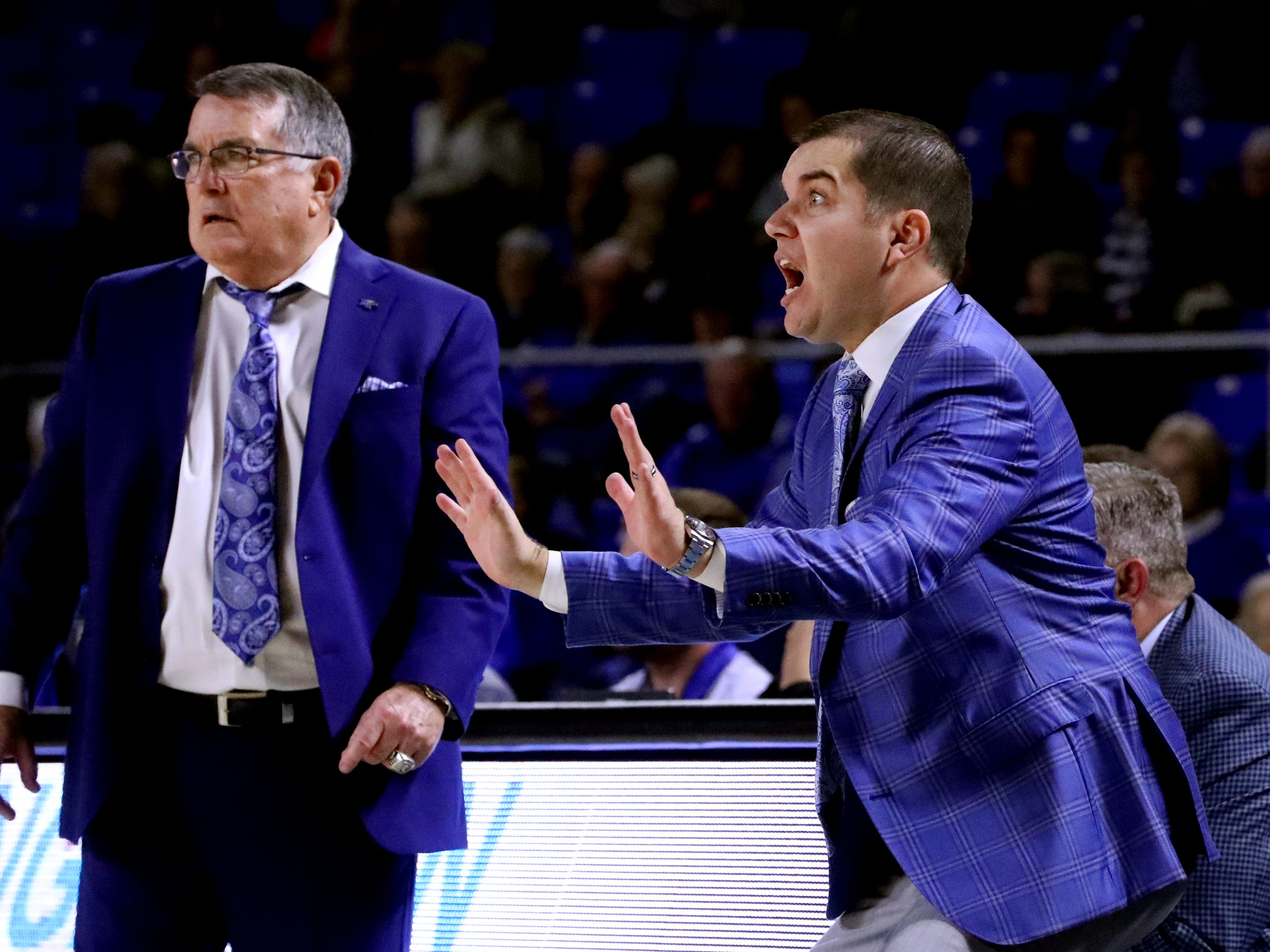 MTSU's head basketball coach Rick Insell, left and assistant MTSU basketball coach Matt Insell on the sidelines during the game against Vanderbilt during MTSU women's home opening game at MTSU on Friday, Nov. 8, 2018.