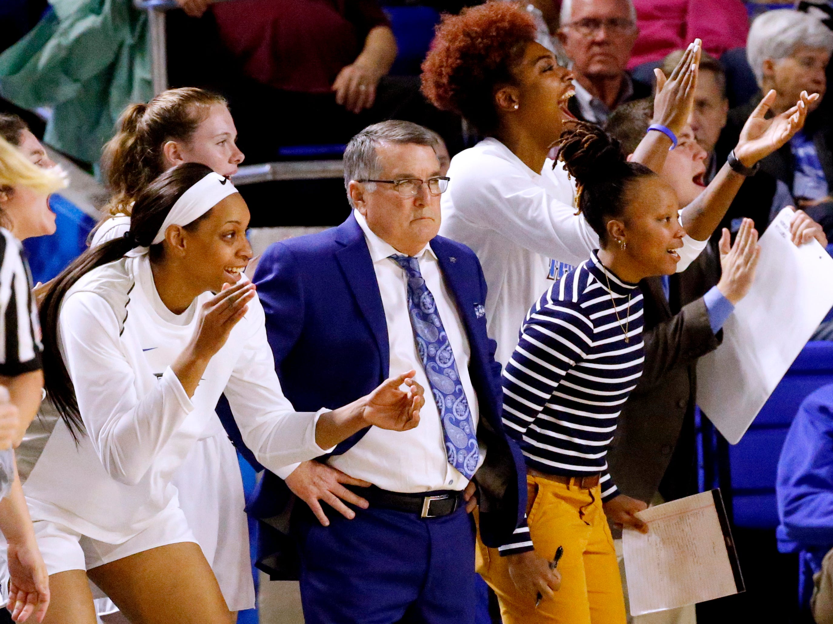 MTSU's head women's basketball coach Rick Insell watches the game from the sidelines as the bench cheers on MTSU against Vanderbilt during MTSU women's home opening game at MTSU on Friday, Nov. 8, 2018.