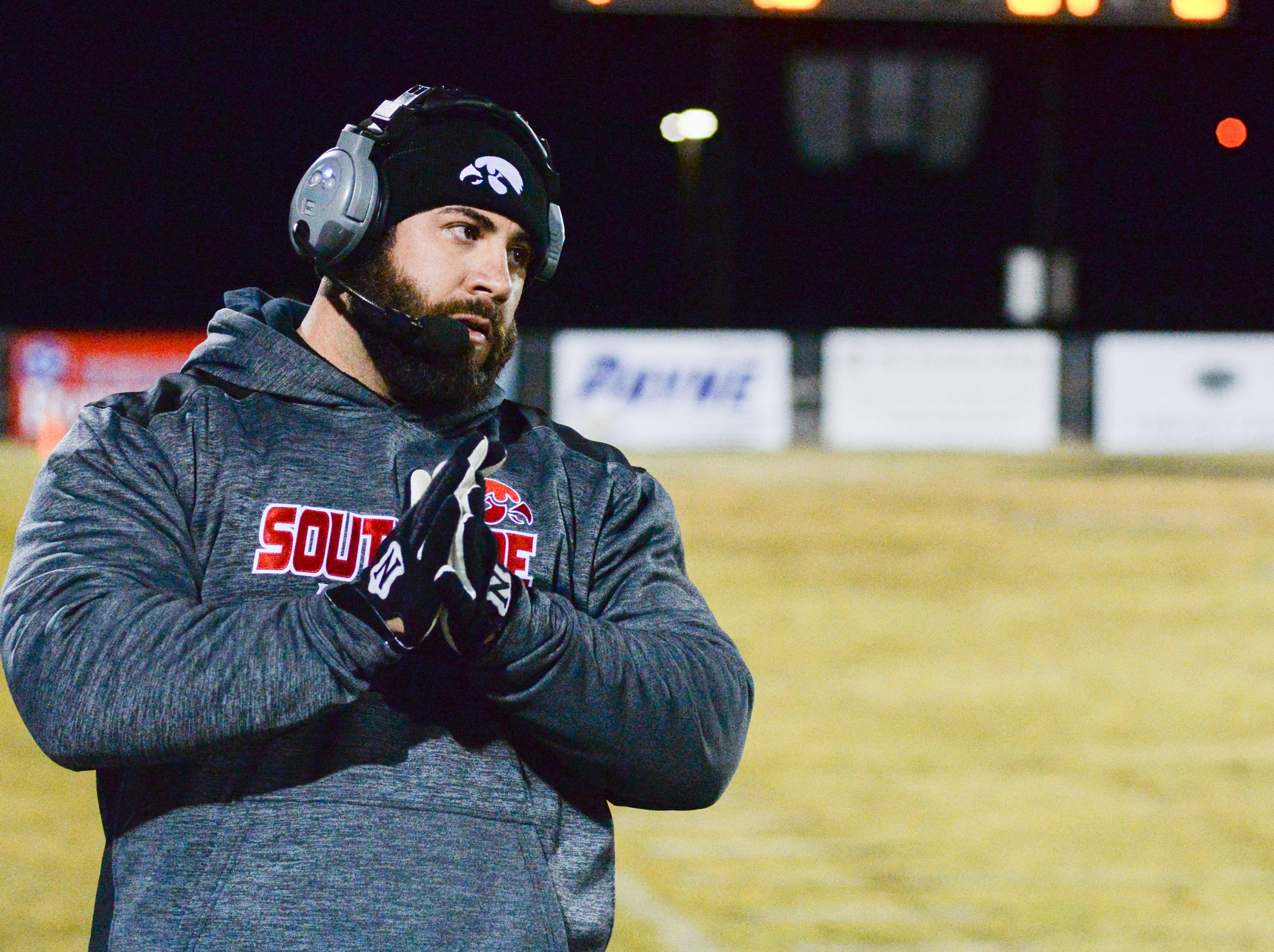 South Side High School coach Tyler Reeder keeps a close eye on the action at Springfield High School on Friday, Nov. 9.