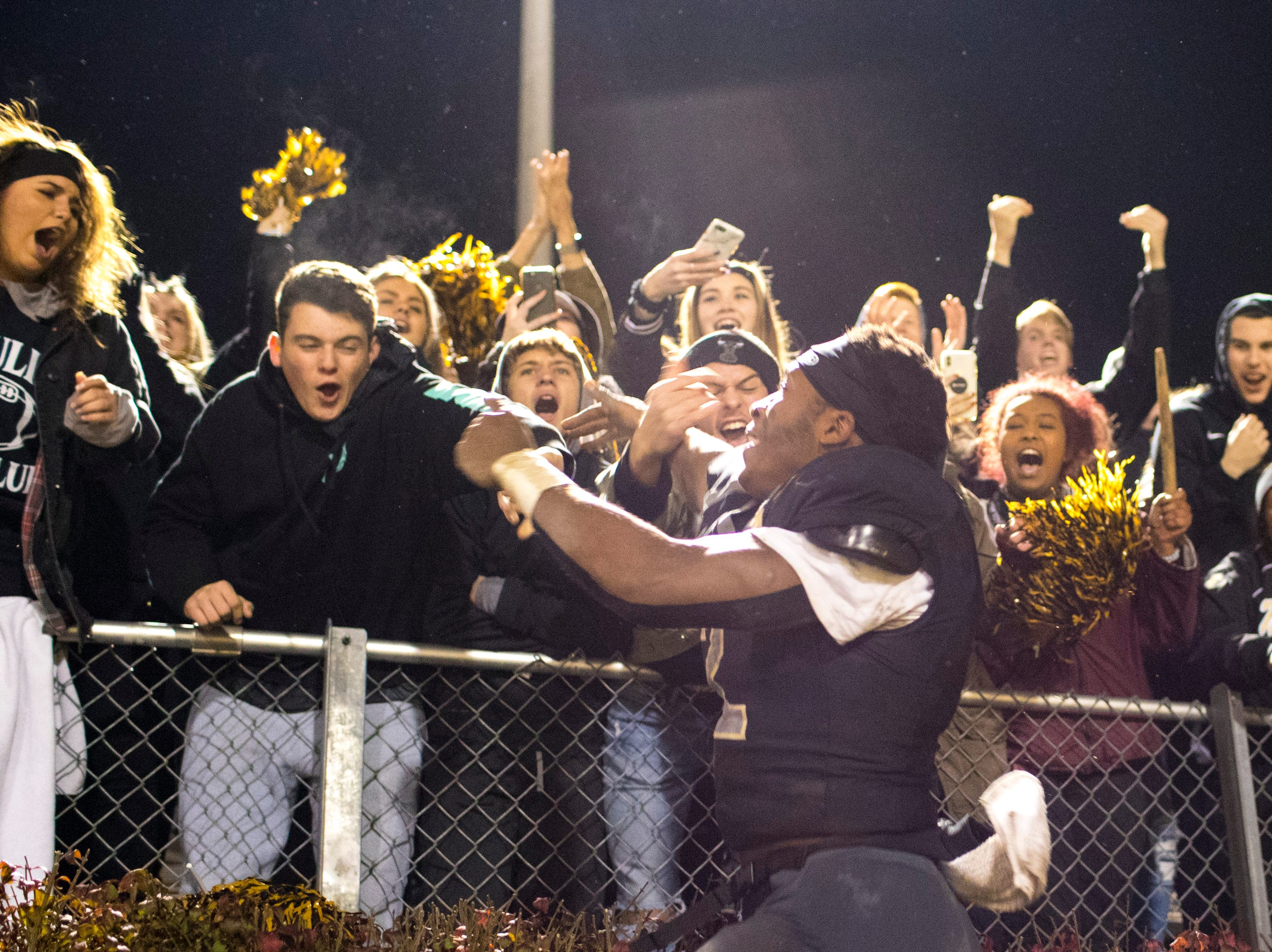 Mt. Juliet's Marcello Walton (2) jumps up to the student section after Mt. Juliet's game against Blackman at Mt. Juliet High School in Mt. Juliet on Friday, Nov. 9, 2018.