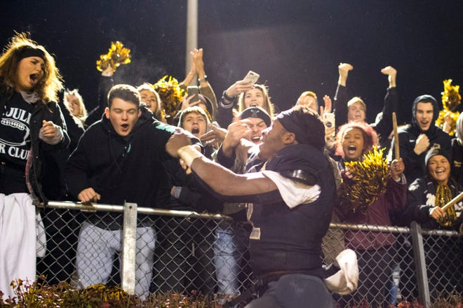 Marcello Walton celebrates with the student section after Mt. Juliet upset Blackman in the TSSAA playoffs on Nov. 9.