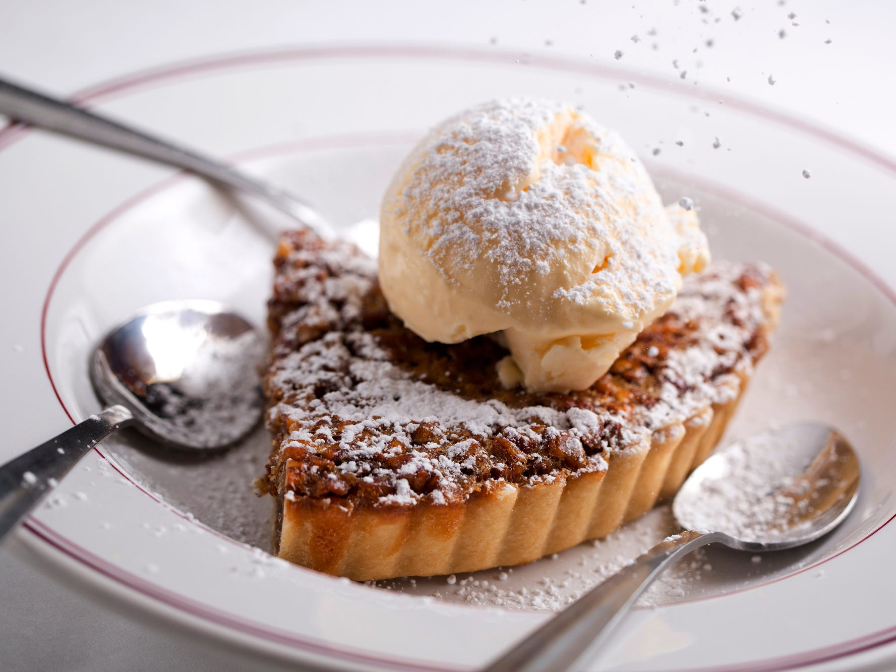 Housemade Southern pecan pie topped with vanilla ice cream at Char Restaurant in Green Hills.