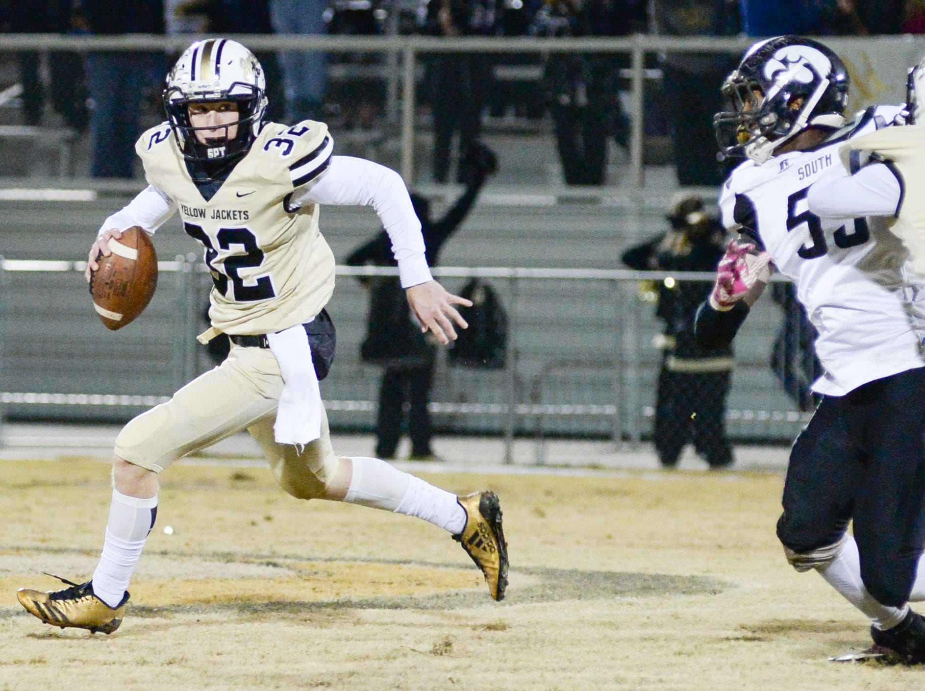 Bryan Hayes (32) carries the ball during a game against South Side School at Springfield High School on Friday, Nov. 9.