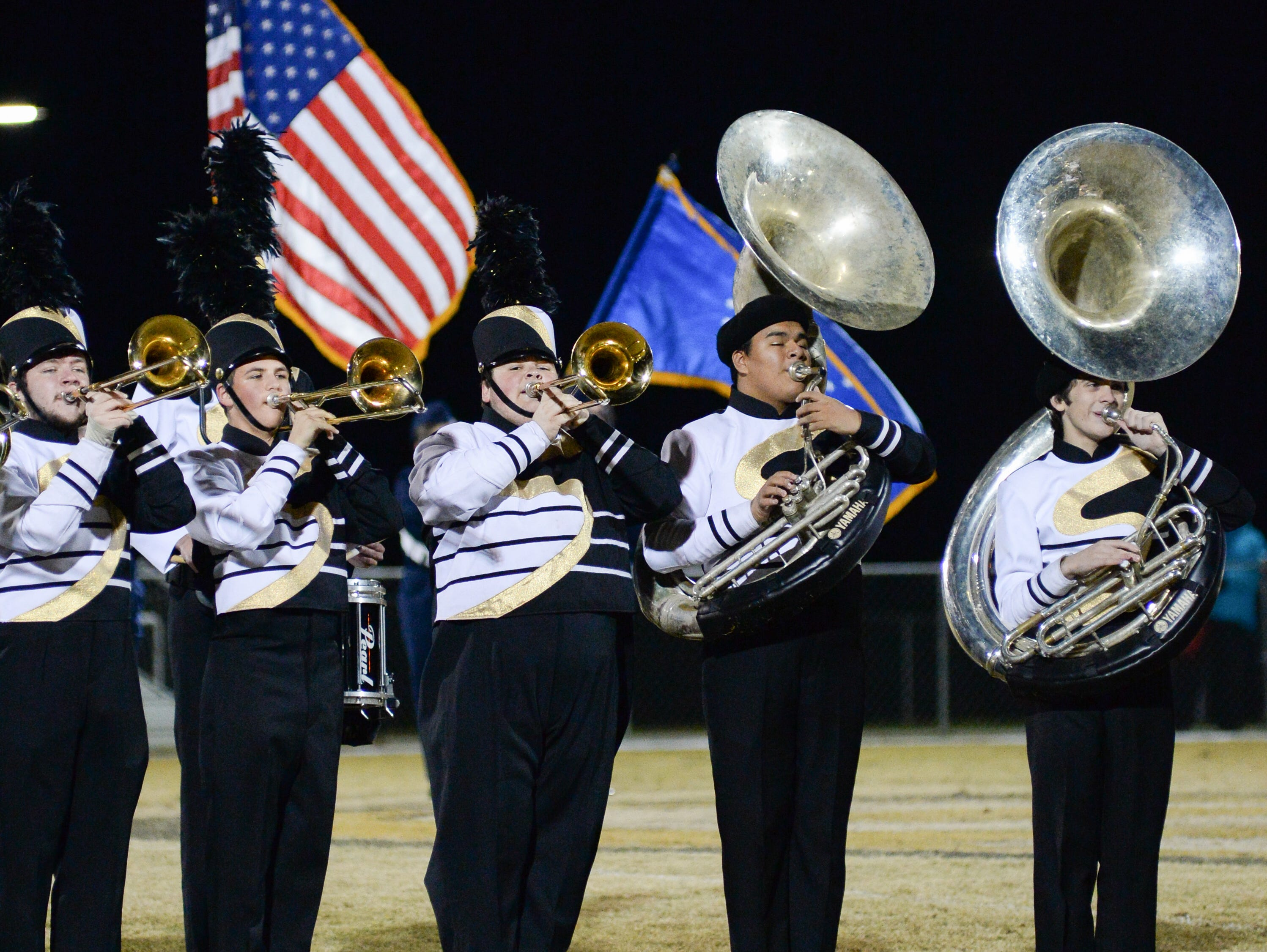 Springfield High School band performs the National Anthem before a game against South Side High School at Springfield High School on Friday, Nov. 9.