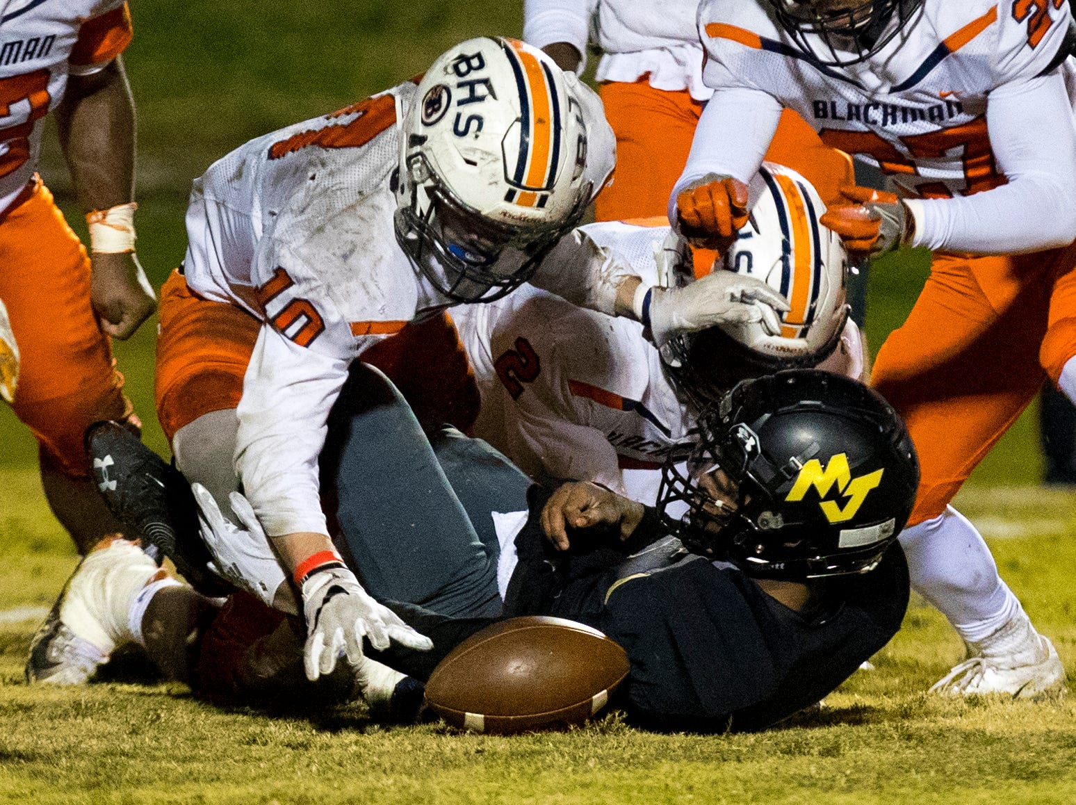 Blackman's Dejeun Gibson (10) falls on a loose ball during Mt. Juliet's game against Blackman at Mt. Juliet High School in Mt. Juliet on Friday, Nov. 9, 2018.