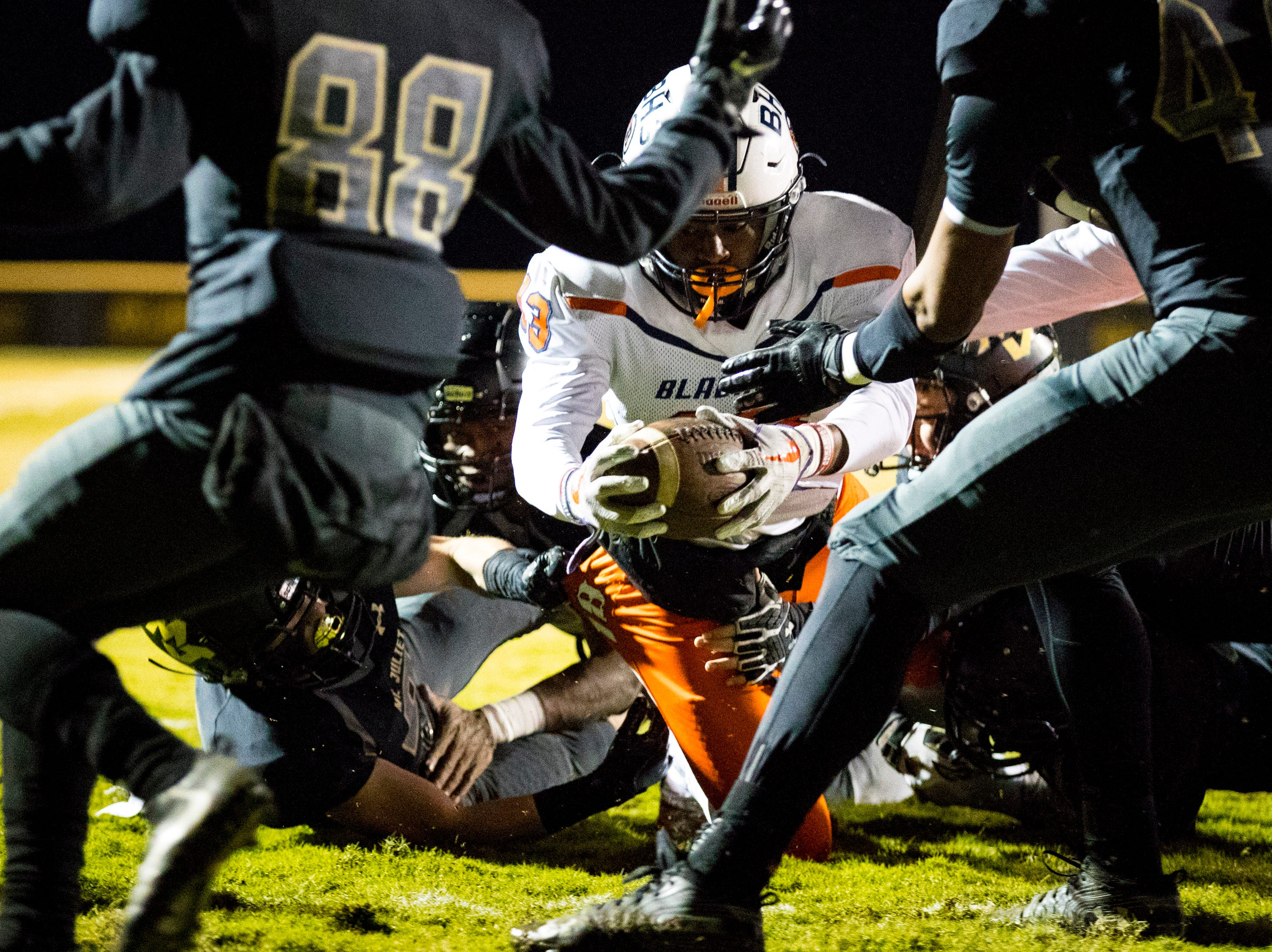 Blackman's Trey Knox (13) falls into the end zone during Mt. Juliet's game against Blackman at Mt. Juliet High School in Mt. Juliet on Friday, Nov. 9, 2018.