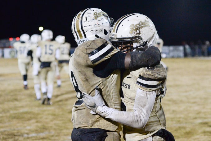 Springfield High School players show their excitement after a win over South Side High School at Springfield High School on Friday, Nov. 9.
