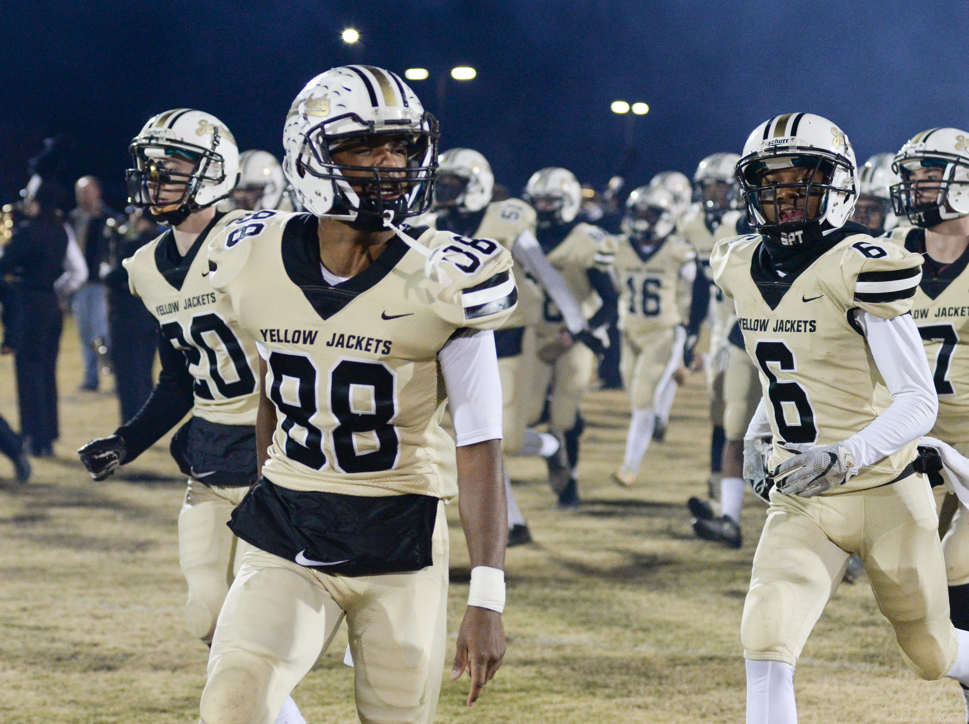 Springfield High School players take the field before playing against South Side High School at Springfield High School on Friday, Nov. 9.