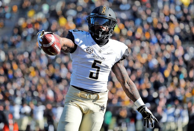 Vanderbilt running back Ke'Shawn Vaughn celebrates as he runs into the end zone after catching a pass for a touchdown during the first half of an NCAA college football game against Missouri Saturday, Nov. 10, 2018, in Columbia, Mo.
