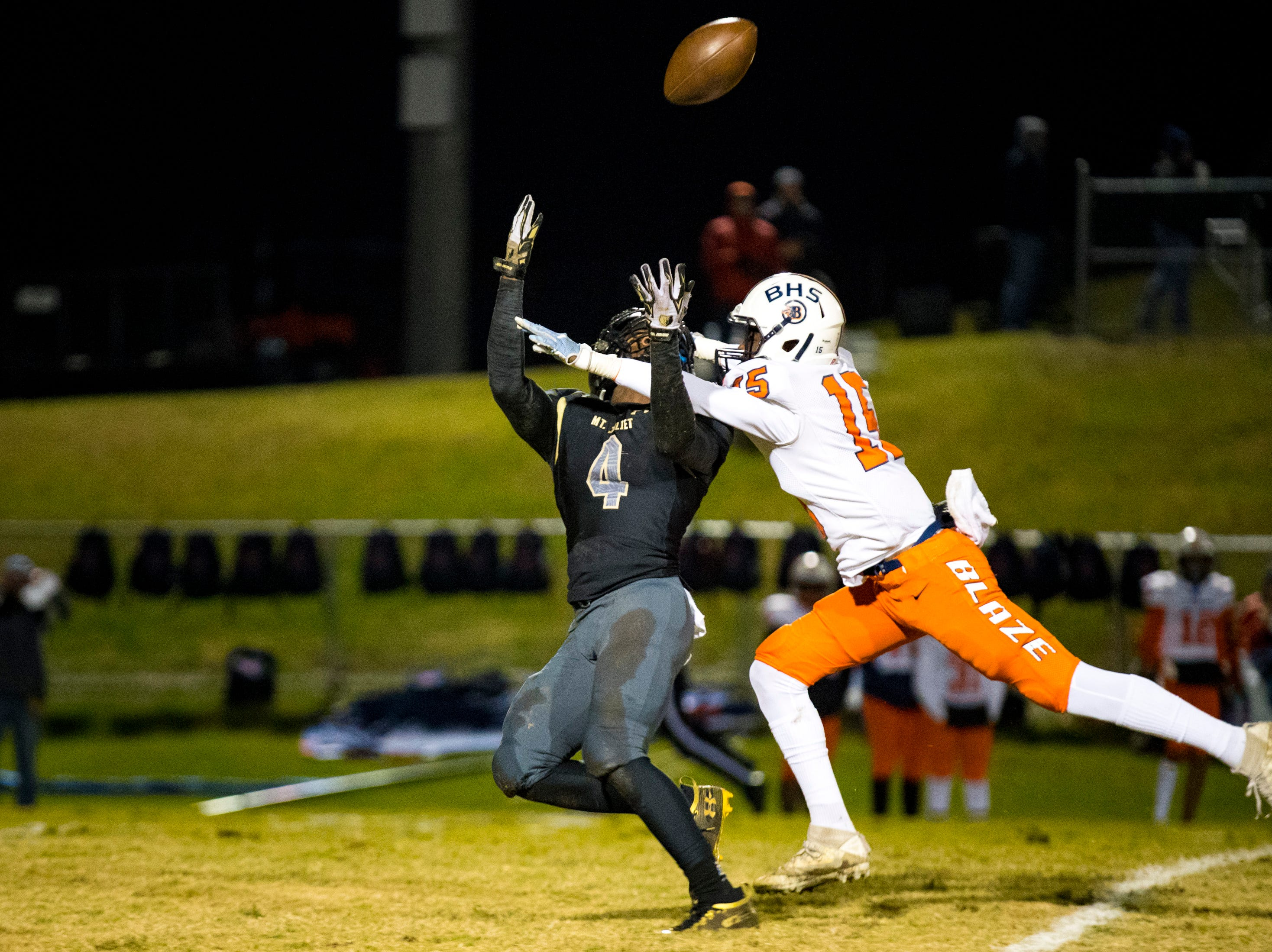 Blackman's Camden Williams (15) defends a pass intended for Mt. Juliet's Michael Ruttlen (4) during Mt. Juliet's game against Blackman at Mt. Juliet High School in Mt. Juliet on Friday, Nov. 9, 2018.