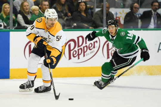 Nov 10, 2018; Dallas, TX, USA; Nashville Predators defenseman Roman Josi (59) plays the puck ahead of Dallas Stars center Tyler Pitlick (18) during the second period at American Airlines Center. Mandatory Credit: Shanna Lockwood-USA TODAY Sports