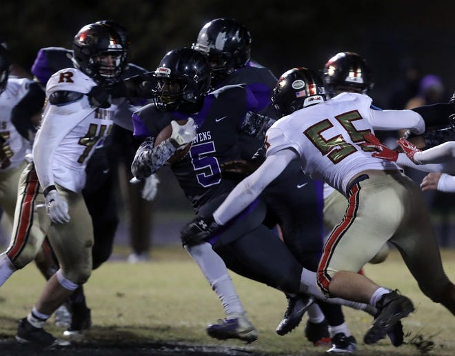 Ravenwood's Reagan Carlson attempts to tackle Devon Starling of Cane Ridge during their 2018 TSSAA play-off game at Cane Ridge Friday, November 9, 2018.