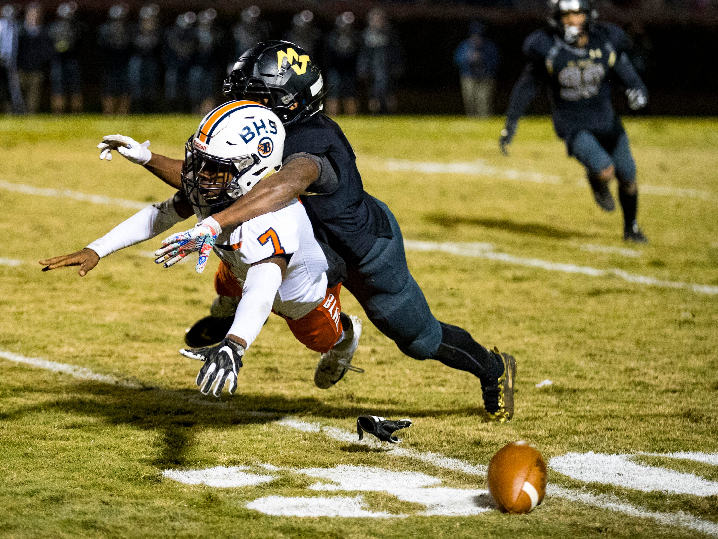 Blackman's Michaleous Elder (7) tries for a pass under tight coverage during Mt. Juliet's game against Blackman at Mt. Juliet High School in Mt. Juliet on Friday, Nov. 9, 2018.