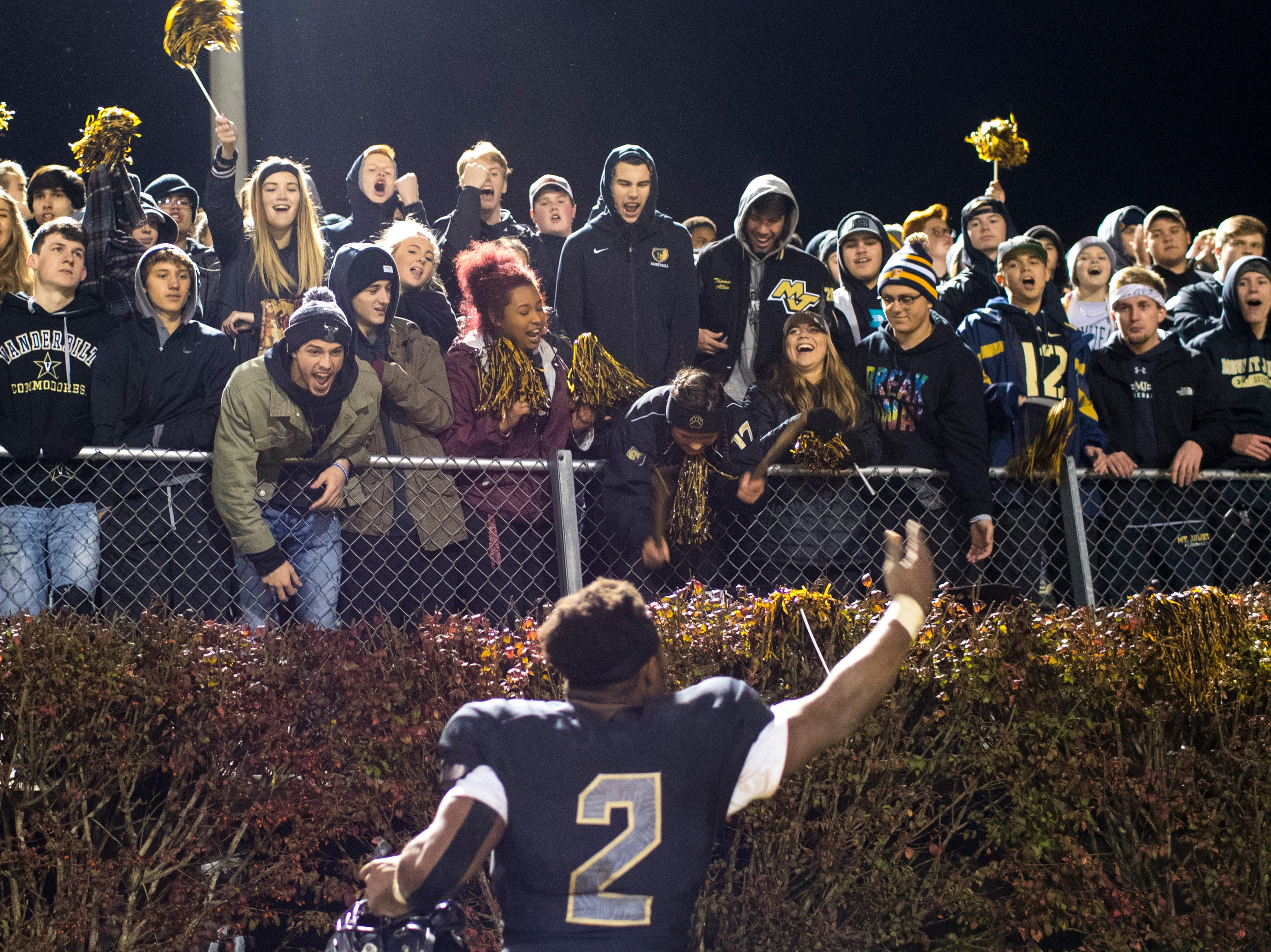 Mt. Juliet's Marcello Walton (2) tries to hype up the Mt. Juliet student section during Mt. Juliet's game against Blackman at Mt. Juliet High School in Mt. Juliet on Friday, Nov. 9, 2018.