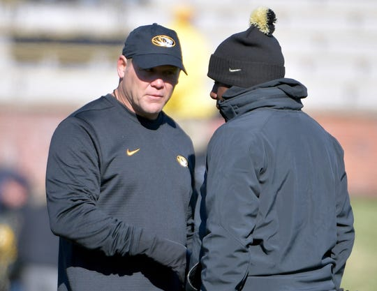 Missouri Tigers head coach Barry Odom (left) talks with Vanderbilt Commodores head coach Derek Mason before the game at Memorial Stadium/Faurot Field.