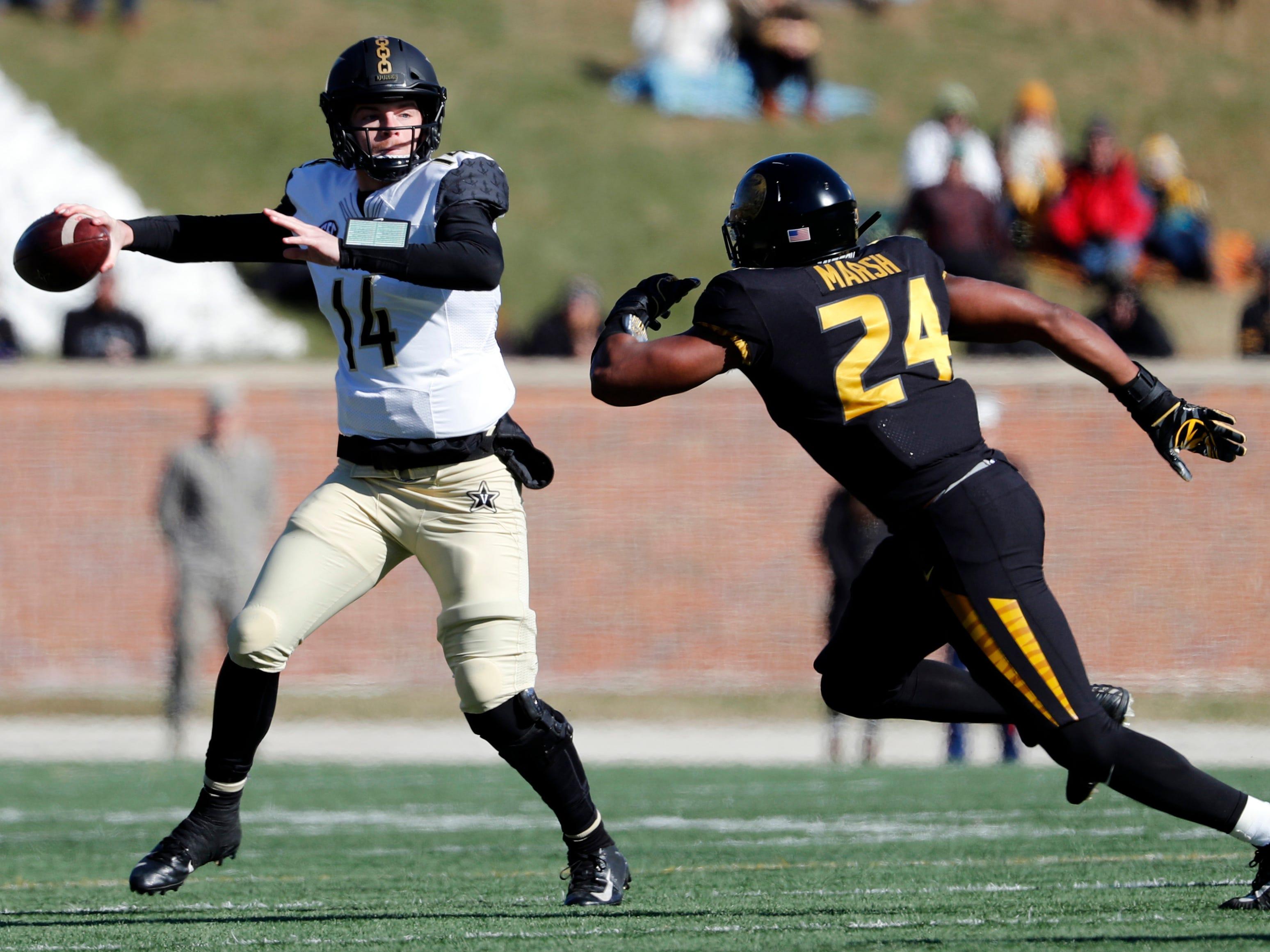 Vanderbilt quarterback Kyle Shurmur, left, throws under pressure from Missouri linebacker Terez Hall during the first half of an NCAA college football game Saturday, Nov. 10, 2018, in Columbia, Mo.