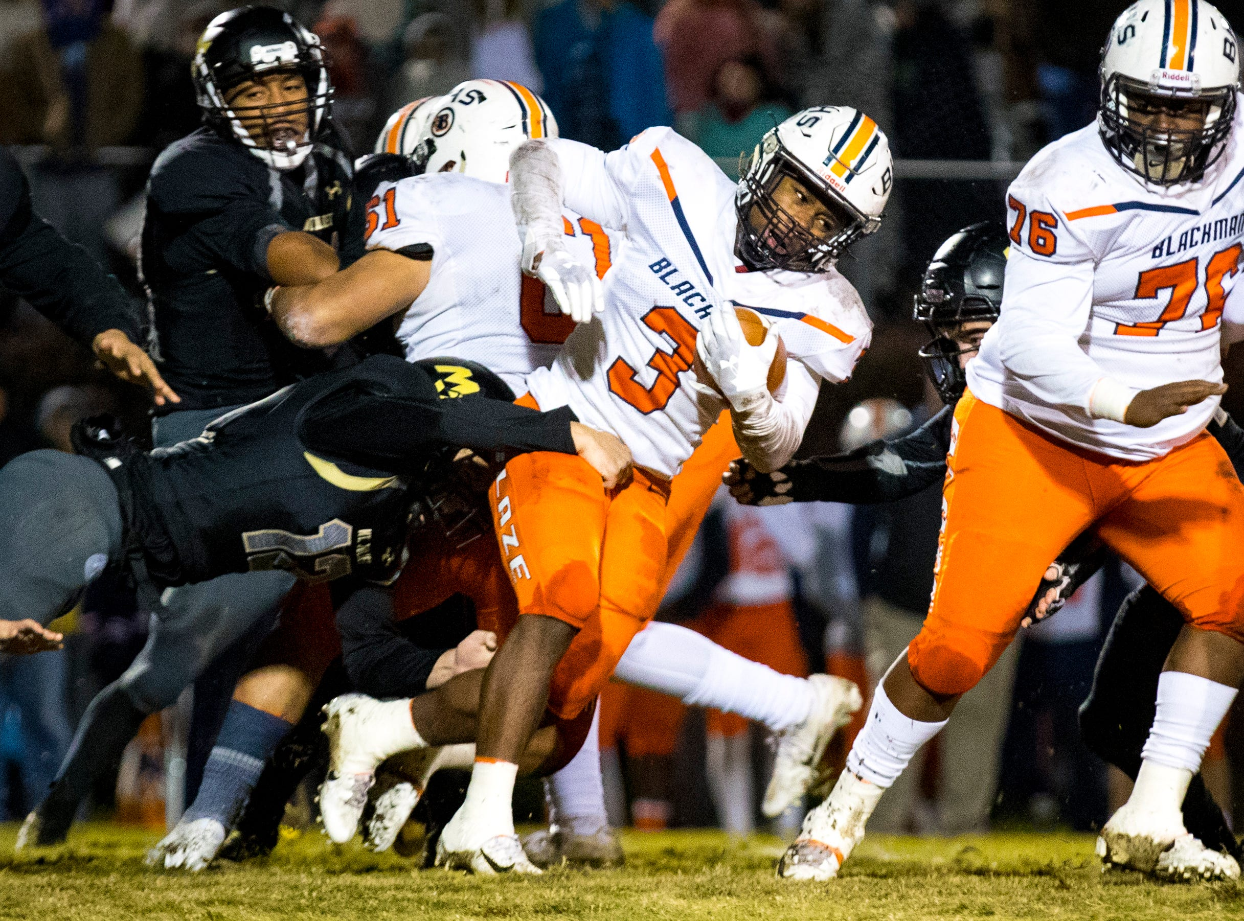 Mt. Juliet's Cage Ellis (12) holds onto Blackman's Ta'Micus Napier (3) during Mt. Juliet's game against Blackman at Mt. Juliet High School in Mt. Juliet on Friday, Nov. 9, 2018.