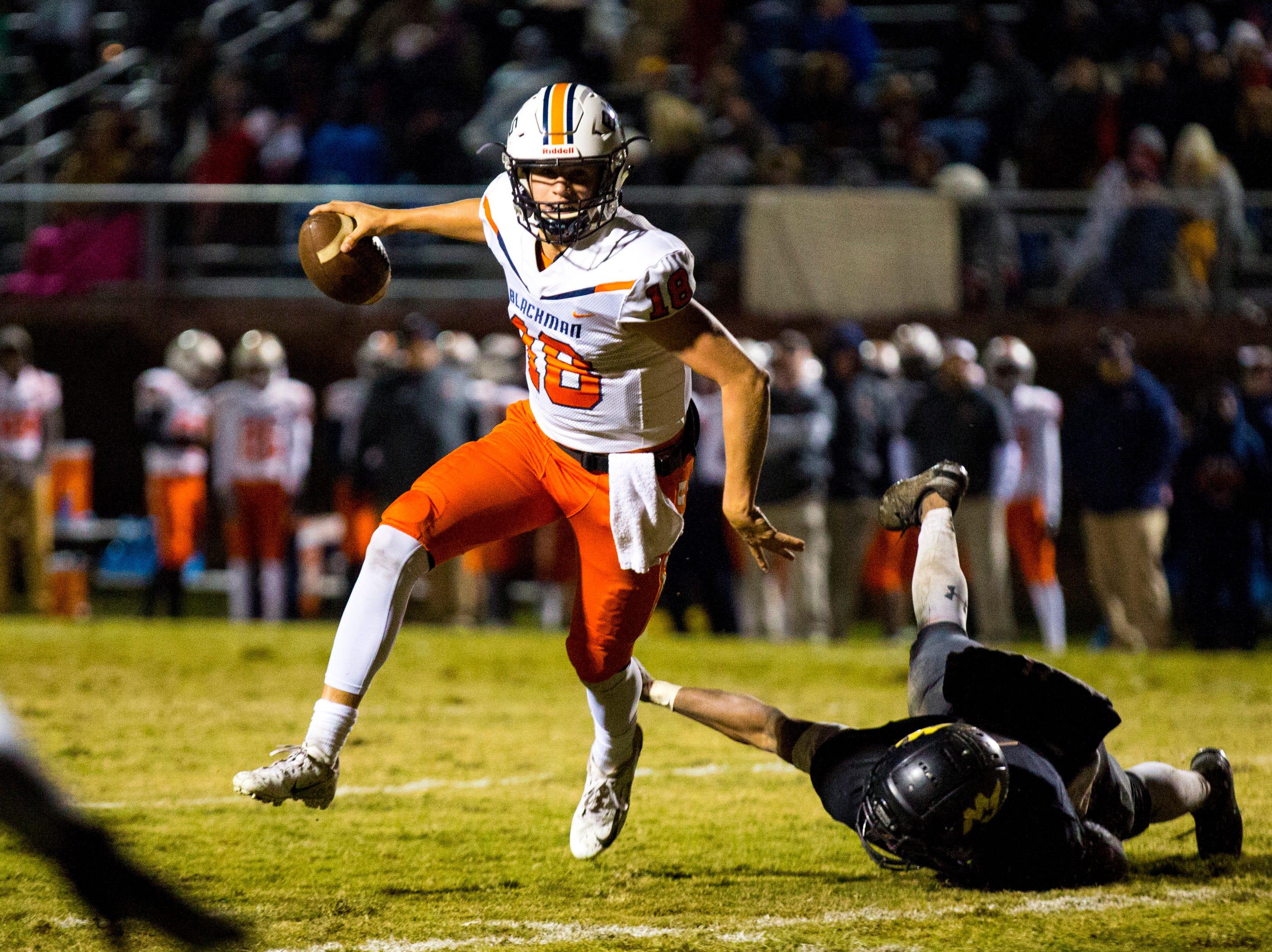Blackman's Drew Beam (18) dodges a tackle during Mt. Juliet's game against Blackman at Mt. Juliet High School in Mt. Juliet on Friday, Nov. 9, 2018.