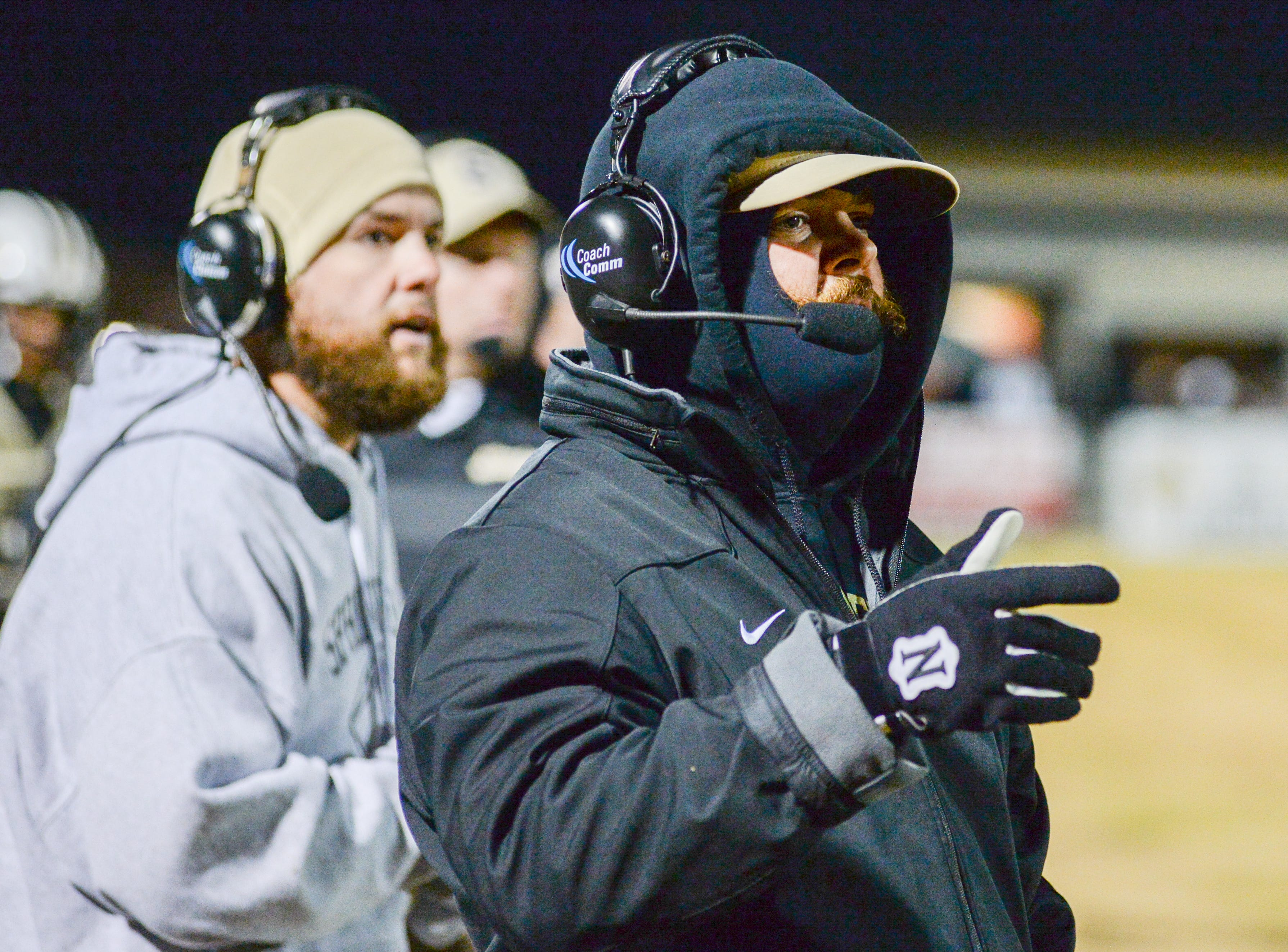Springfield High School coach Dustin Wilson checks out the situation during a game against South Side School at Springfield High School on Friday, Nov. 9.