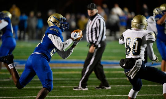 Xiere Howard intercepts a pass intended for Chayce Bishop as Independence plays at Brentwood during the Class 6A second round game