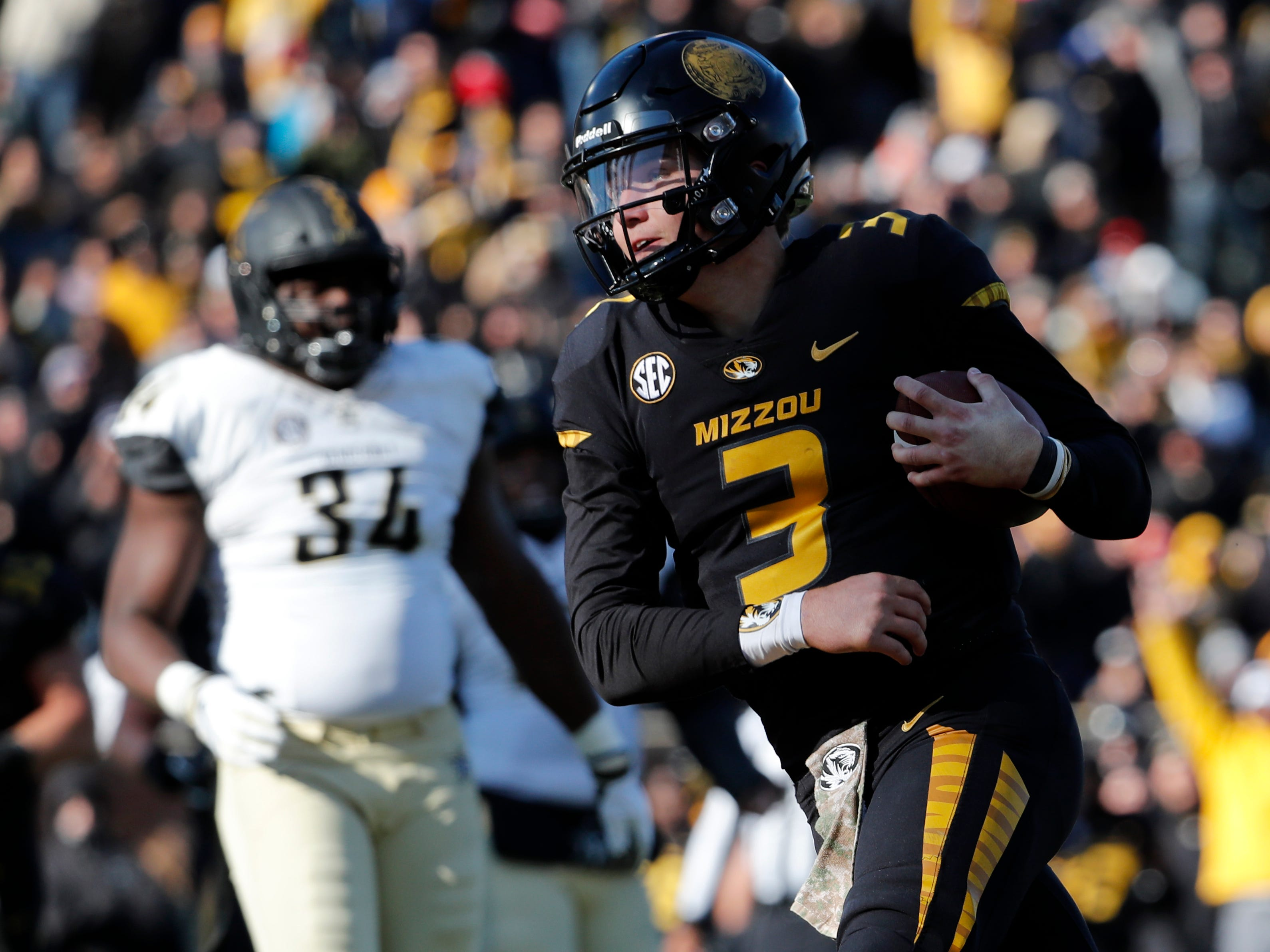 Missouri quarterback Drew Lock scores on a 3-yard touchdown run during the second half of an NCAA college football game against Vanderbilt Saturday, Nov. 10, 2018, in Columbia, Mo. Missouri won 33-28.