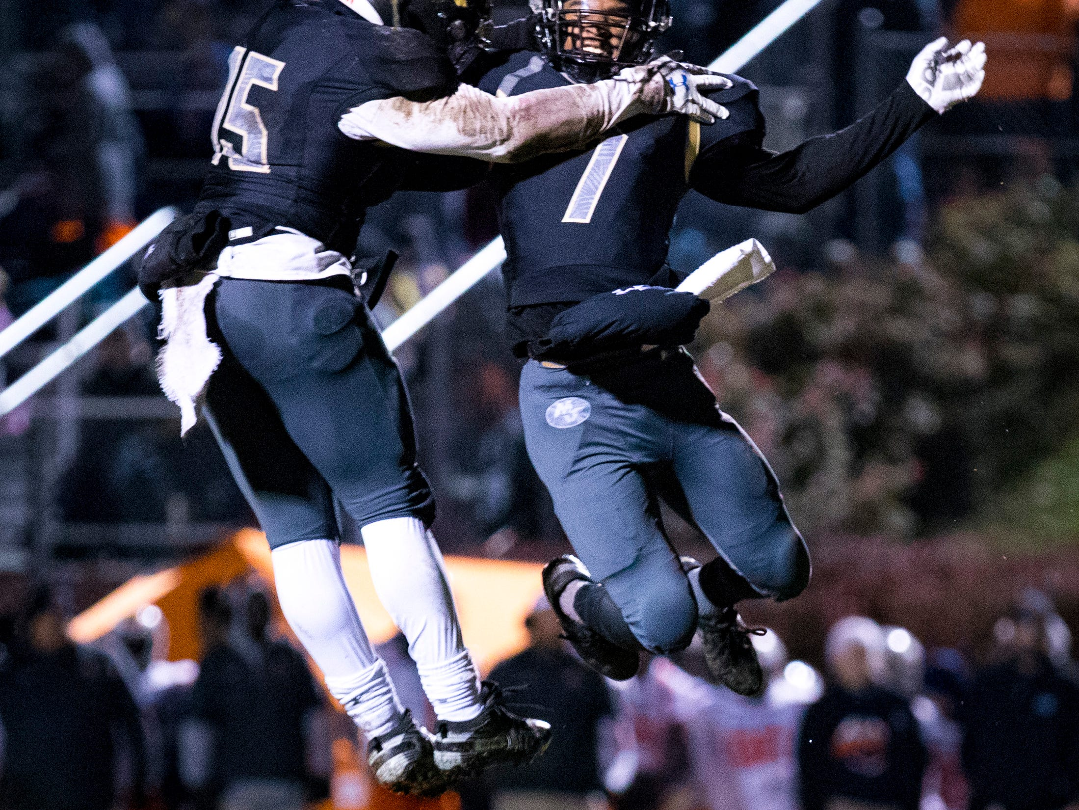 Mt. Juliet's Alvin Mixon (7) celebrates with Mt. Juliet's Justin Harrigan (15) after Mixon scored a touchdown during Mt. Juliet's game against Blackman at Mt. Juliet High School in Mt. Juliet on Friday, Nov. 9, 2018.