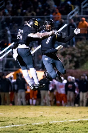 Mt. Juliet's Alvin Mixon (7) celebrates with Mt. Juliet's Justin Harrigan (15) after Mixon scored a touchdown during Mt. Juliet's game against Blackman at Mt. Juliet High School in Mt. Juliet on Friday, Nov. 9, 2018.
