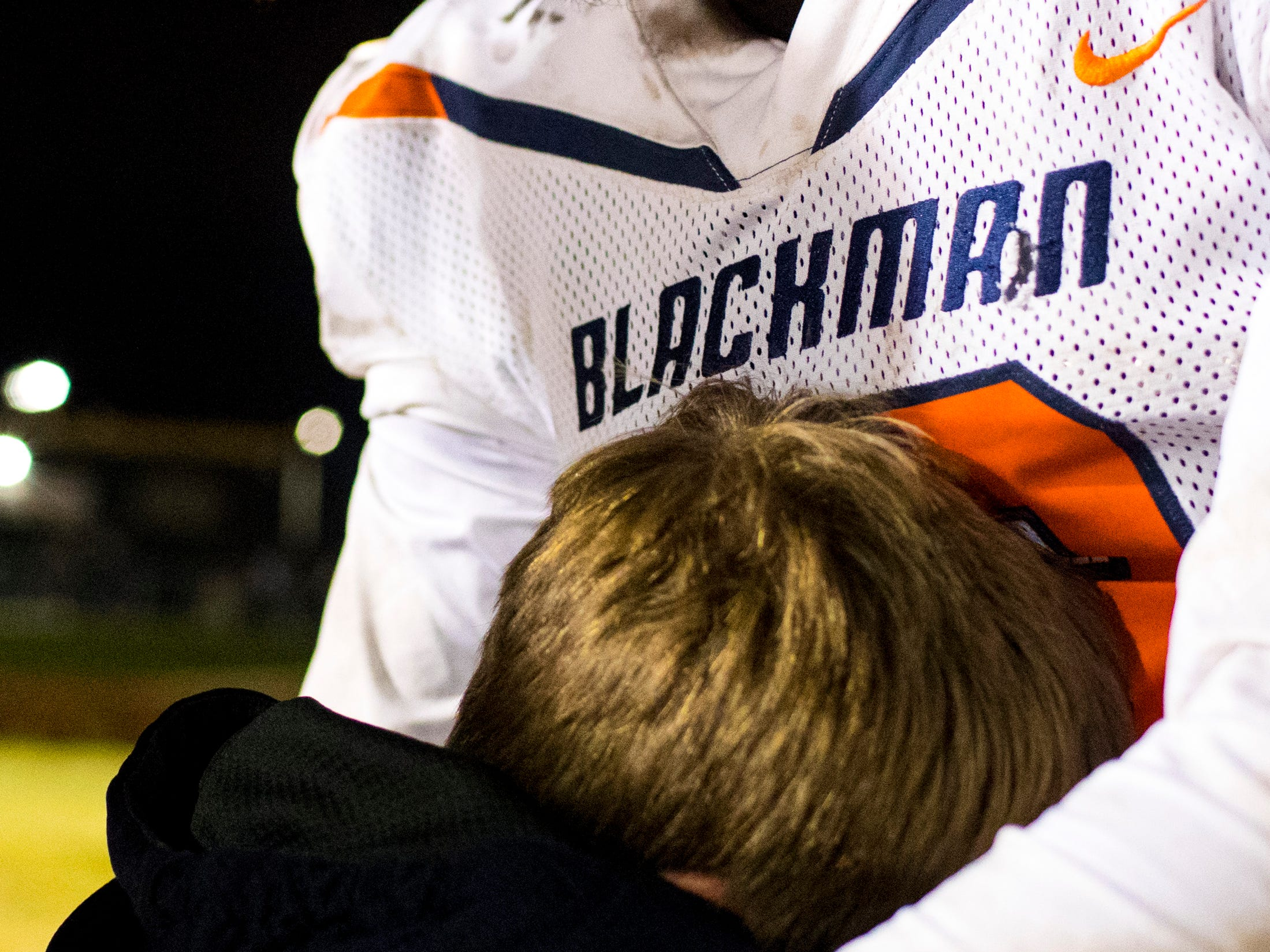 Blackman's Trey Knox (13) comforts a young fan after Mt. Juliet's game against Blackman at Mt. Juliet High School in Mt. Juliet on Friday, Nov. 9, 2018.