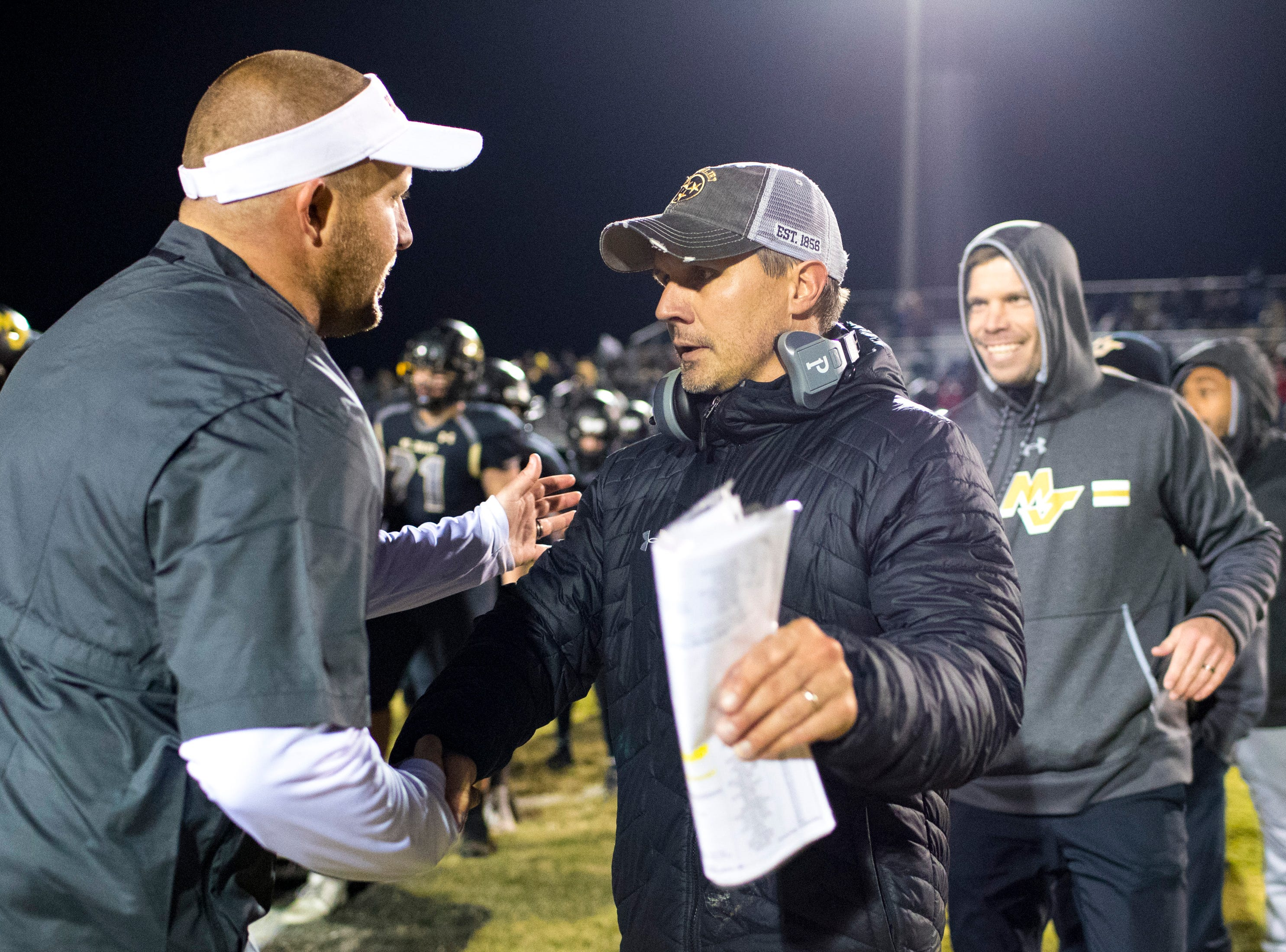 Mt. Juliet's head coach Trey Perry and Blackman's head coach Kit Hartsfield shake hands after Mt. Juliet's game against Blackman at Mt. Juliet High School in Mt. Juliet on Friday, Nov. 9, 2018.