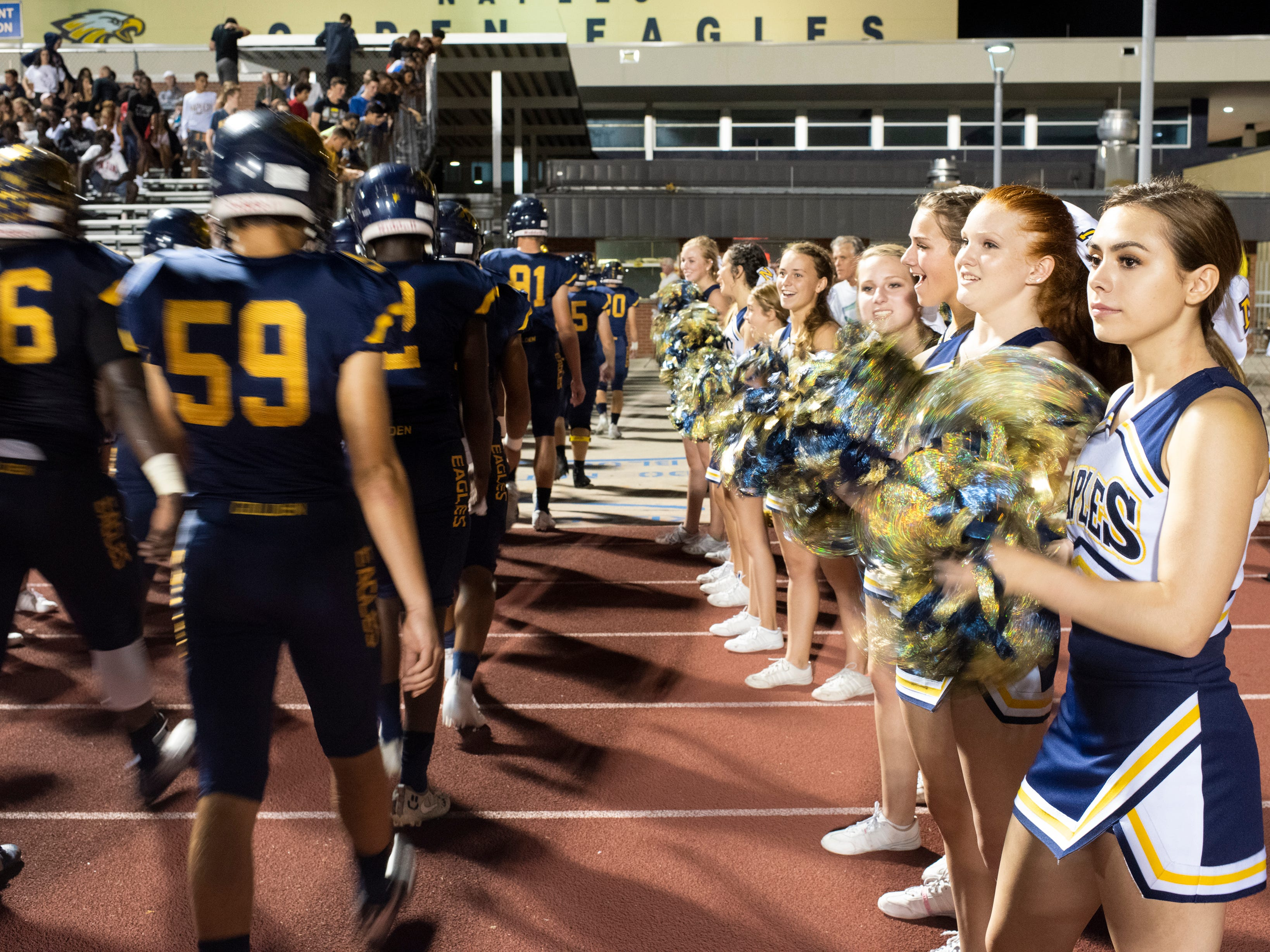 Naples cheerleaders cheer as the team heads for the locker room for half time in the Class 6A regional quarterfinal playoff game abasing Lehigh at Naples High on Friday night, November 9, 2018.