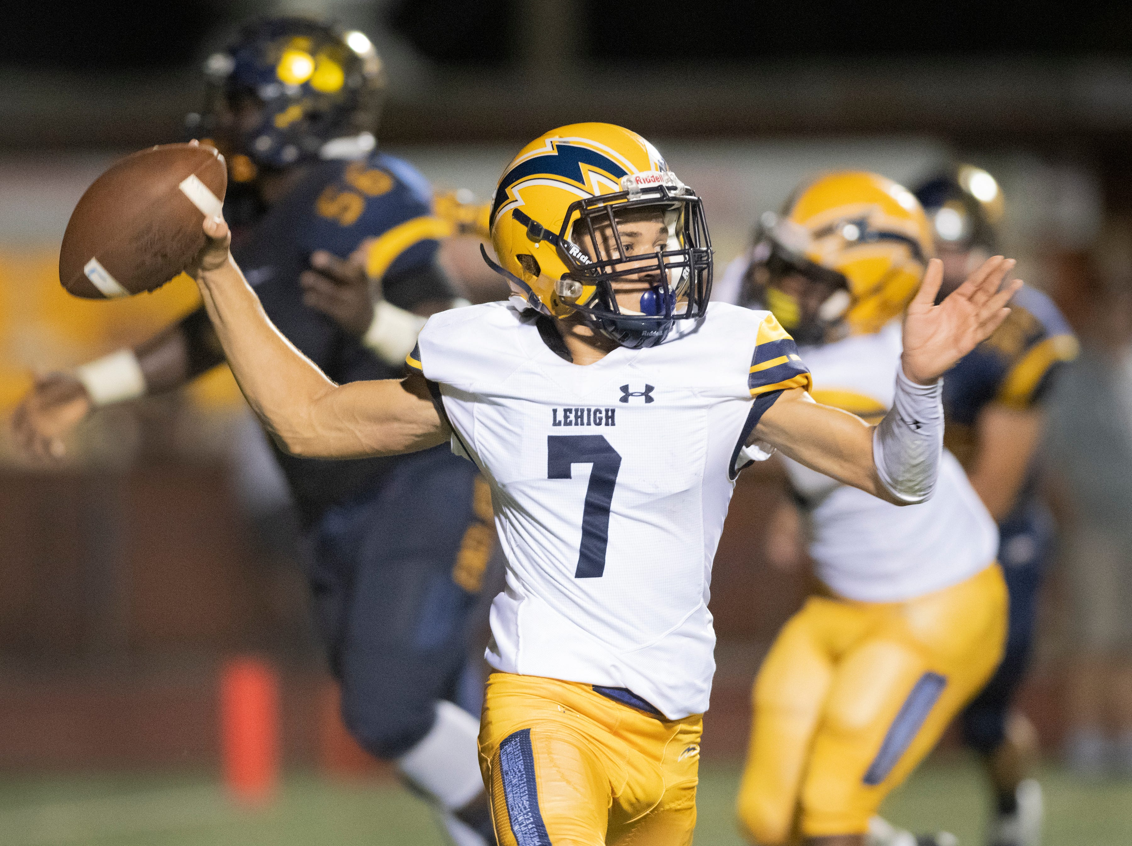 D'Mateo Collins of Lehigh throws a pass during the Class 6A regional quarterfinal playoff game against Naples at Naples High on Friday night, November 9, 2018.