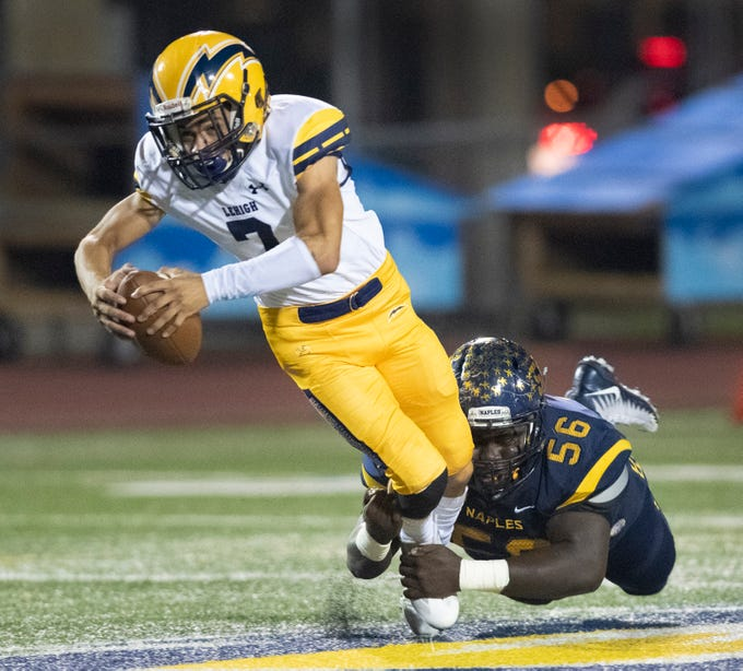 Loobert Denelus of Naples sacks Lehigh quarterback D'Mateo Collins during the Class 6A regional quarterfinal playoff game at Naples High on Friday night, November 9, 2018.