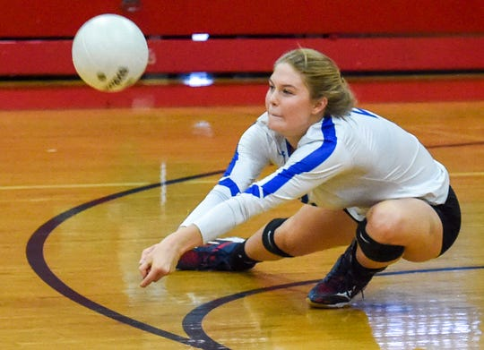 Barron Collier's Elizabeth Bradley (2) digs the ball Saturday during her team's high school state semifinal volleyball match against South Fork at South Fork High School in Tropical Farms. South Fork defeated Barron Collier 3-2.