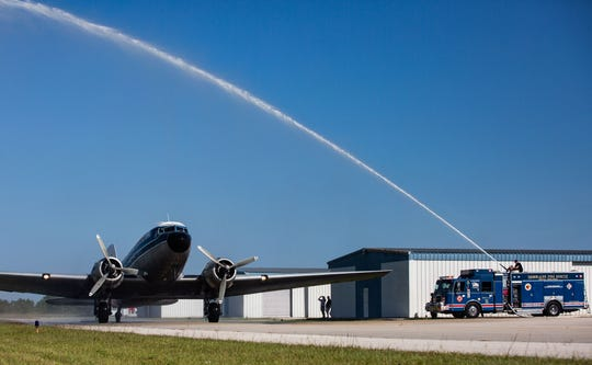 The Immokalee Fire Rescue honors the Douglas DC-3 flight with a water cannon salute as the aircraft arrives at the Immokalee Regional Airport, on Saturday, Nov. 10, 2018. The plane, which flew from Fort Lauderdale International Airport for the sixth annual Turkeys Take Flight, carried 300 frozen turkeys and Thanksgiving dinner fixings to be distributed to families with needs in Immokalee.