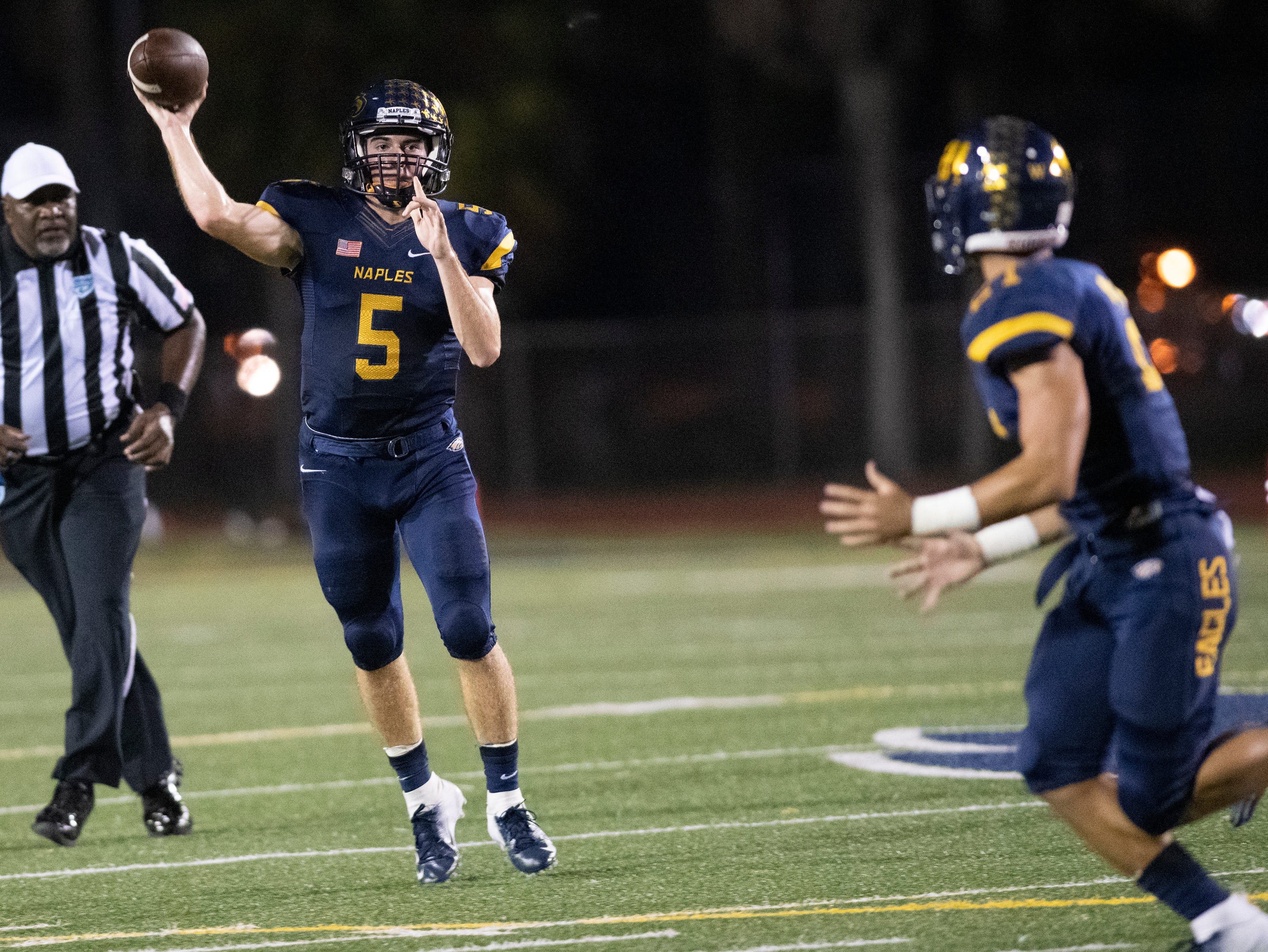 Naples quarterback Drew Wiltsie throws a pass to Chase Bertucci during the Class 6A regional quarterfinal playoff game against Lehigh at Naples High on Friday night, November 9, 2018.