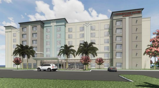 A rendering of the TownePlace Suites Marriott hotel under construction across Juliet Boulevard from the Walmart Supercenter on the south side of Immokalee Road west of Interstate 75 in North Naples.