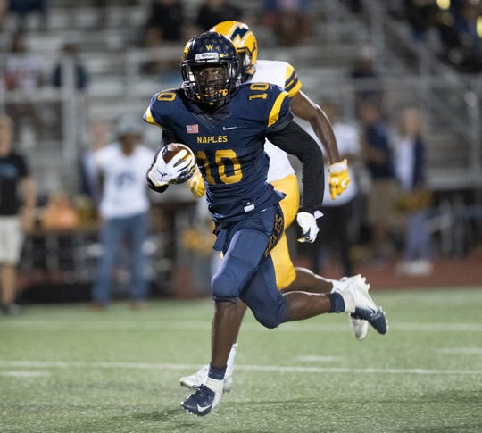 D'Andre St Jean of Naples runs with the ball after making an interception against Lehigh during the Class 6A regional quarterfinal playoff game at Naples High on Friday night, November 9, 2018.