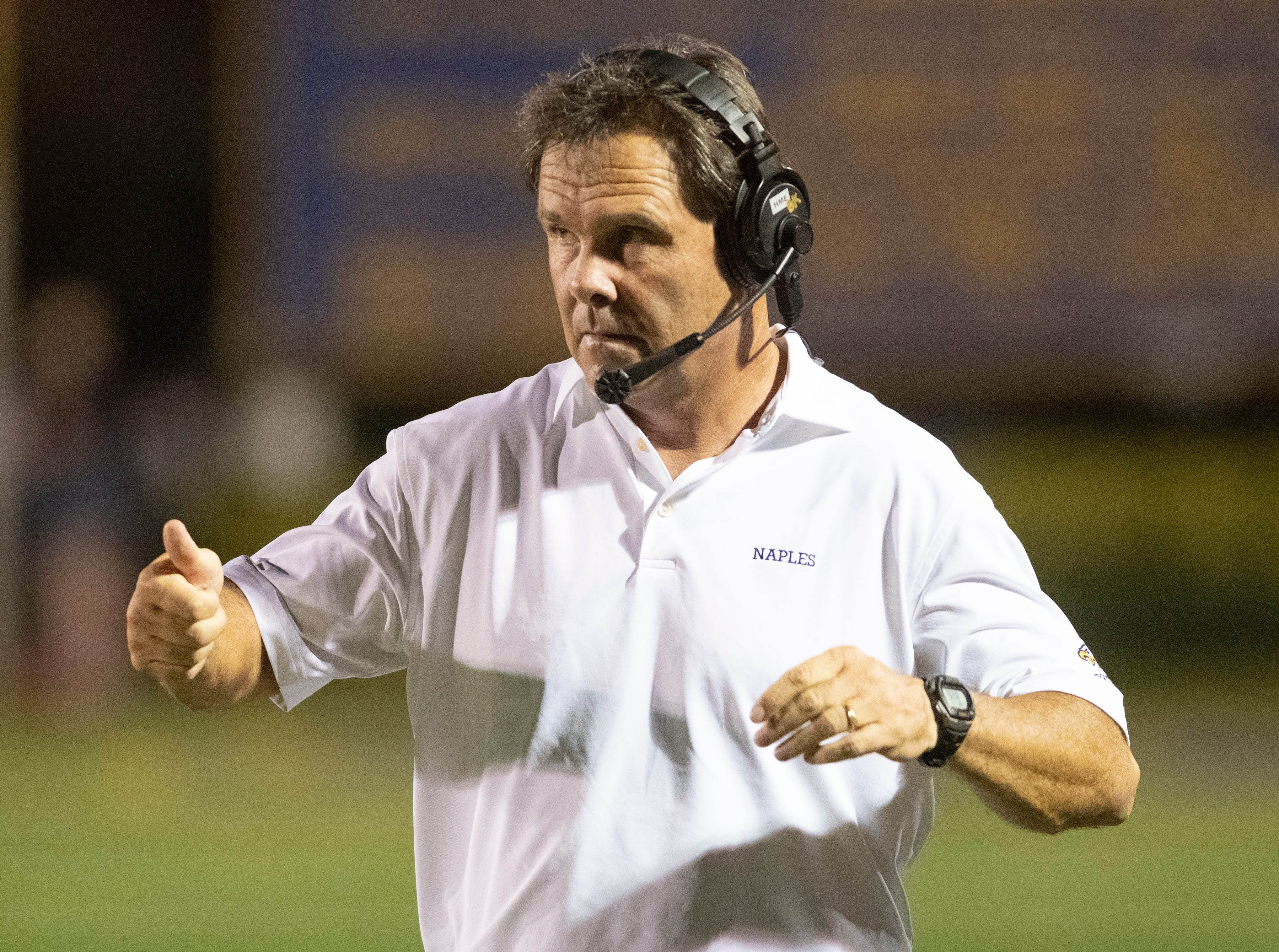 Naples head coach Bill Kramer gives his team a thumbs up during the Class 6A regional quarterfinal playoff game against Lehigh at Naples High on Friday night, November 9, 2018.