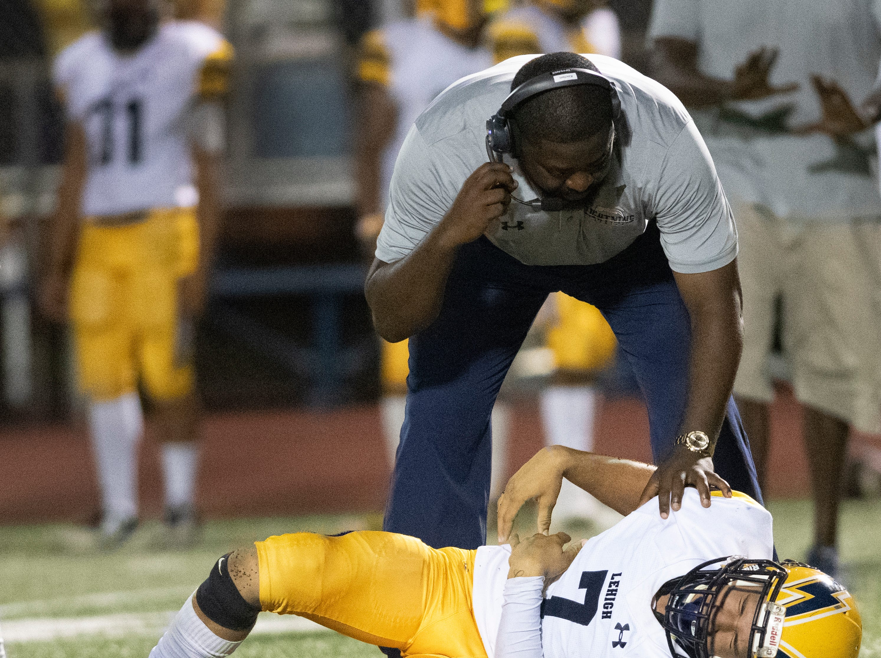 Lehigh quarterback D'Mateo Collins grimaces with pain after being hit by a Naples defender during the Class 6A regional quarterfinal playoff game at Naples High on Friday night, November 9, 2018.