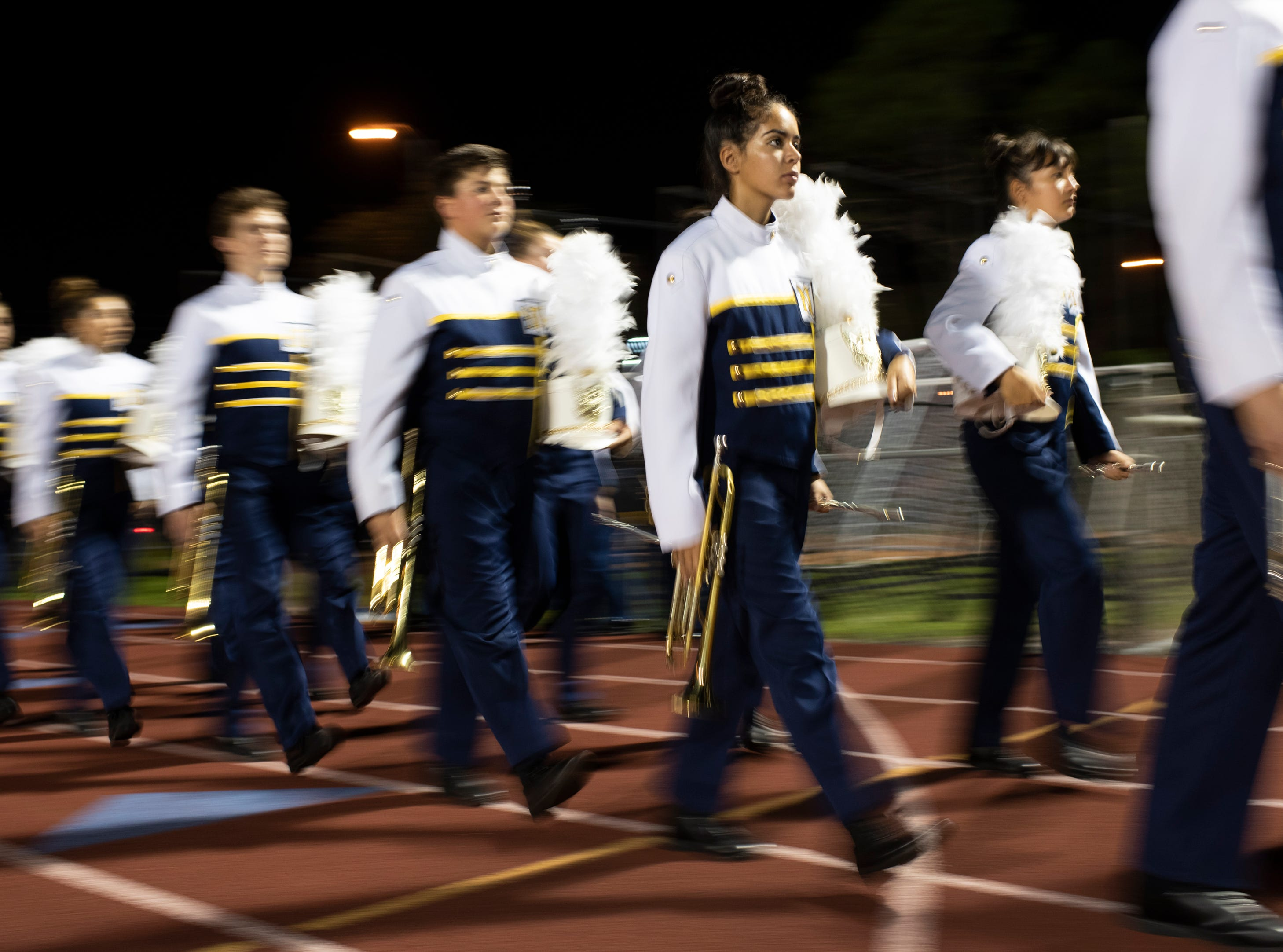 The Naples High marching band marches onto the field before the Class 6A regional quarterfinal playoff game against Lehigh at Naples High on Friday night, November 9, 2018.