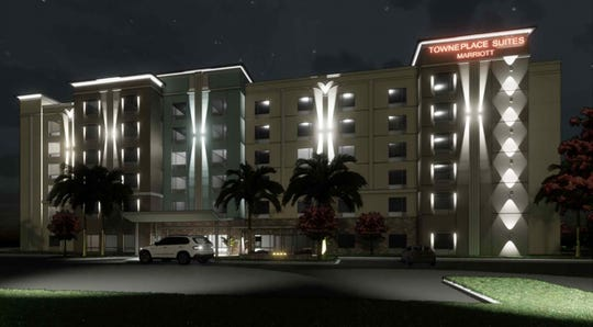 A rendering with a night view of the TownePlace Suites Marriott hotel under construction across Juliet Boulevard from the Walmart Supercenter on the south side of Immokalee Road west of Interstate 75 in North Naples.