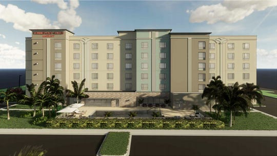 A rendering of the rear of the TownePlace Suites Marriott hotel under construction across Juliet Boulevard from the Walmart Supercenter on the south side of Immokalee Road west of Interstate 75 in North Naples.