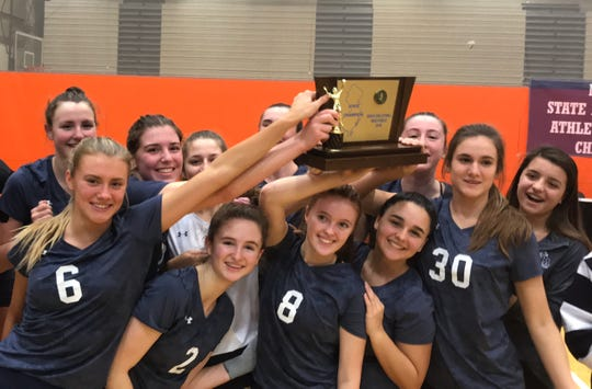 Immaculate Heart volleyball players celebrate with the Non-Public championship trophy, the Blue Eagles' 12th in a row. From the NJSIAA finals at William Paterson University, Saturday, Nov. 10, 2018.