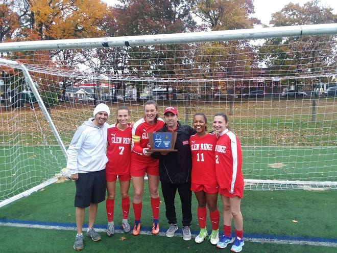 Glen Ridge girls soccer: (from left) assistant Brian Ianni, Jenny Lisovicz, Claire McMahon, coach Oscar Viteri, Halinka Prussak and Jessica Muney.