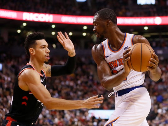 New York Knicks forward Noah Vonleh (right) controls the ball against Toronto Raptors guard Danny Green (left) during the first half at Scotiabank Arena.