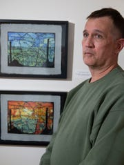 """Artist Ron Erikson with two of his pieces on display At the """"Armistice Day 2018"""" Art Exhibit on November 10, 2018 at the The Puffiin Foundation in Teaneck, NJ."""