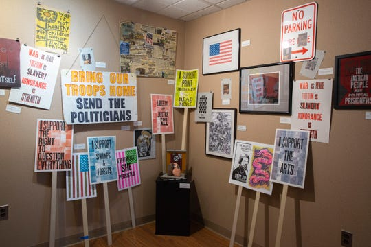A corner of the gallery dedicated to protest art At the Armistice Day 2018 art Exhibit on November 10, 2018 at the The Puffiin Foundation in Teaneck, NJ.