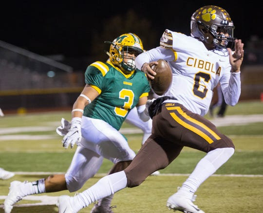 Mayfield's Isaiah Sotelo in pursuit of Cibola's  Marcus Steele during the second quarter of the  first round of Class 6A State Playoffs at the Field of Dreams, Friday November 9, 2018.