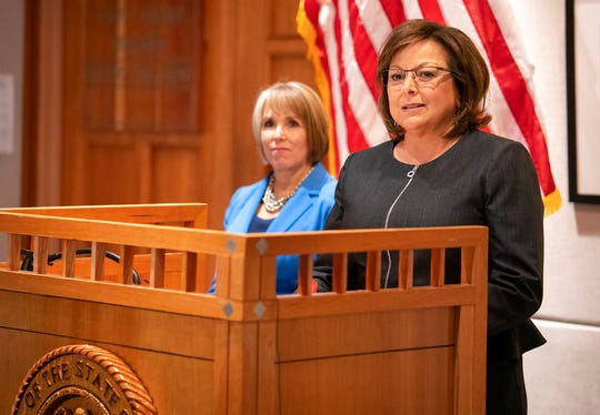 New Mexico Gov. Susana Martinez, right, and U.S. Rep. Michelle Lujan Grisham, who was elected Tuesday as the state's next governor, hold a joint press conference following a meeting at the State Capitol in Santa Fe, N.M., on Friday, Nov. 9, 2018. Martinez, a Republican and the state's first female governor, has served two consecutive terms. Lujan Grisham, a Democrat, will take office Jan. 1, 2019.
